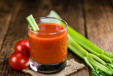 Fresh made Tomato Juice (selective focus) on wooden background. tomato juice