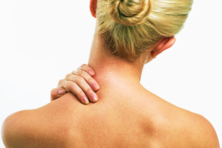 Blond women with neck ache. lond women with neck and backache rubbing area to ease pain