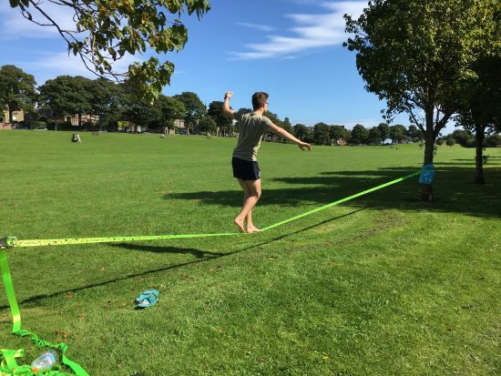 Boy on a tightrope.