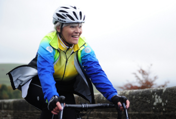 lady on a bike fat lad at the back