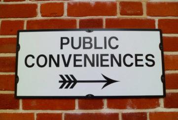'Public Conveniences' Sign & Arrow Symbol