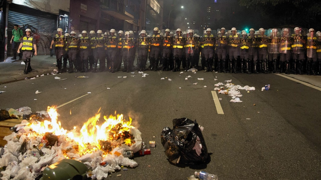 Riot police take position during a protest against money spent on the World Cup preparations in Sao Paulo, Brazil