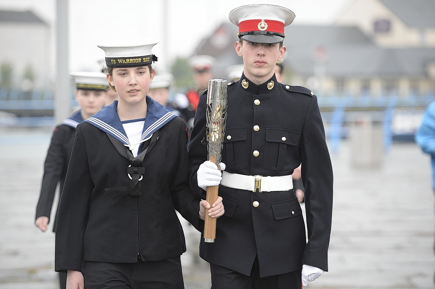 Sian and James McGilton of the TS Warrior Sea Cadets, carry the Commonwealth Games Baton in Carrickfergus