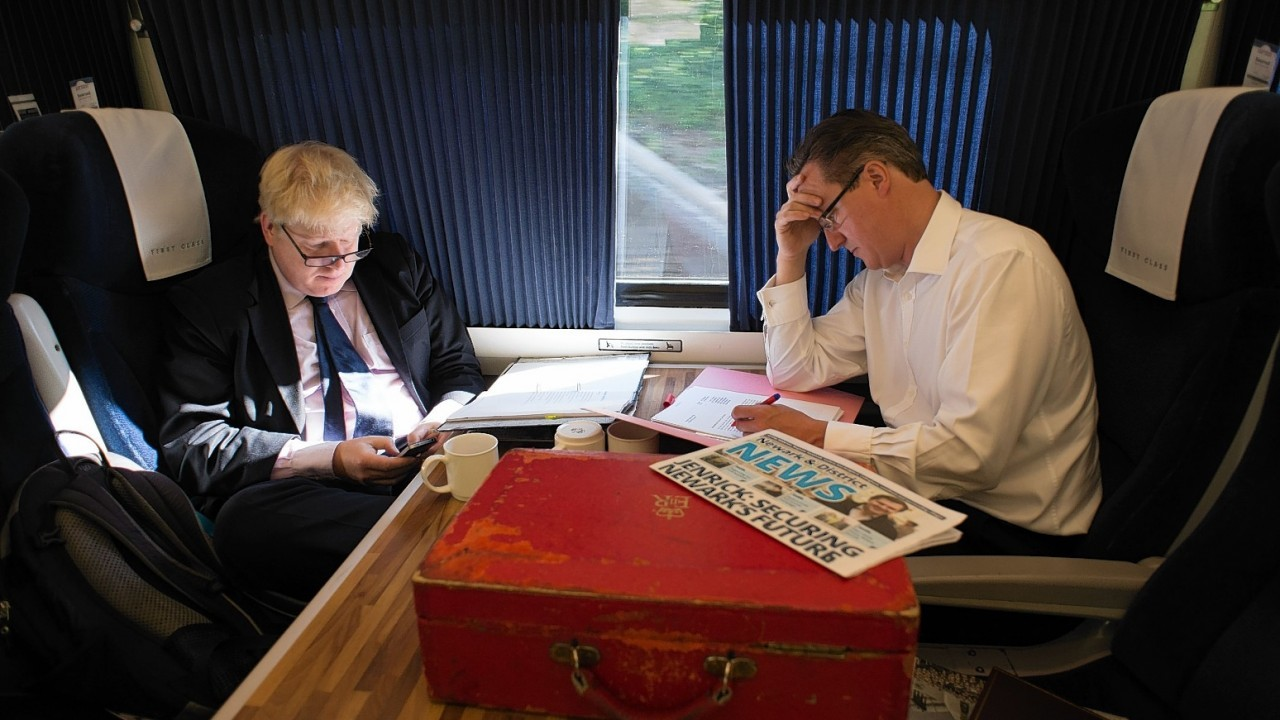 Prime Minister David Cameron and Mayor of London Boris Johnson as they travel by train to Newark to campaign for next months by-election