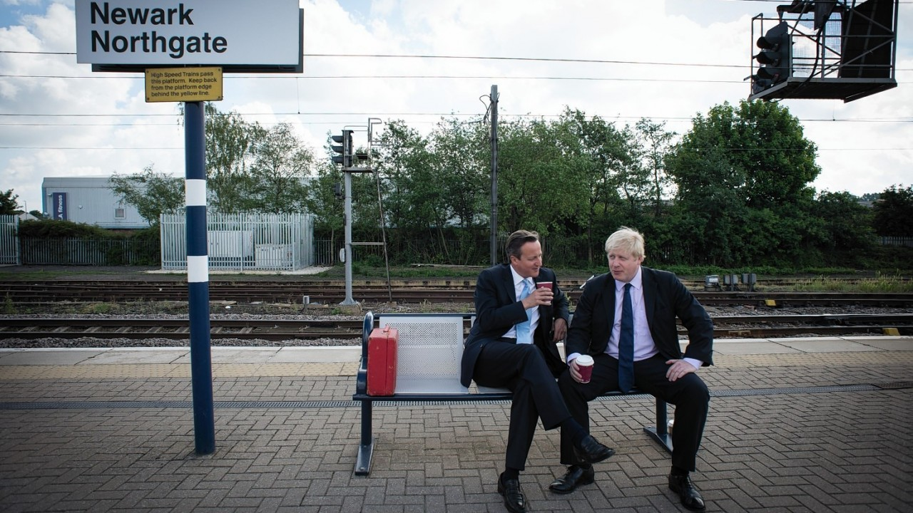 Prime Minister David Cameron and Mayor of London Boris Johnson wait for a train at Newark station following a visit to the town were they campaigned ahead of the by-election which is due on June 5