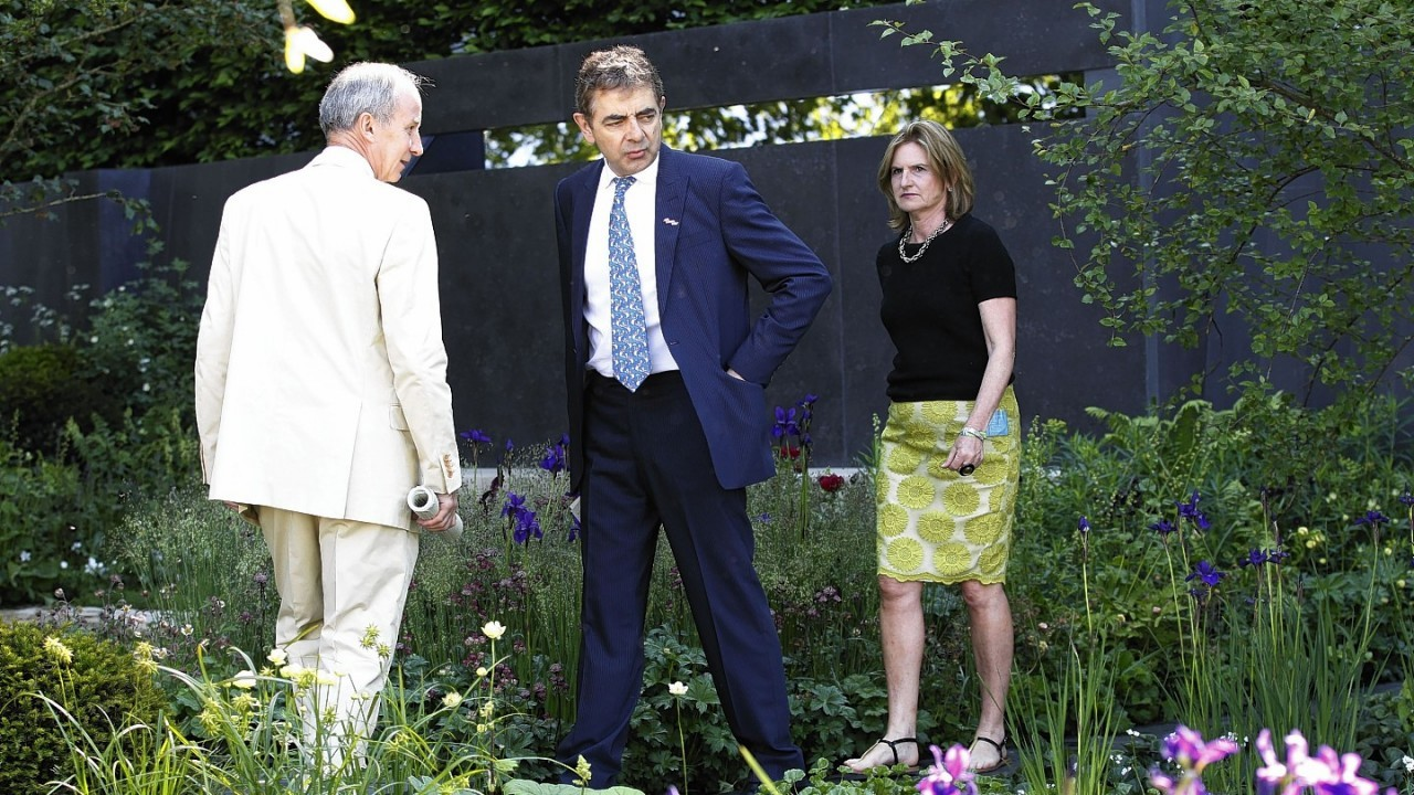 British actor and comedian Rowan Atkinson, center, visits a show garden 'No Man's Land: ABF The Soldiers' Charity Garden to mark the centenary of World War One' at the Chelsea Flower Show