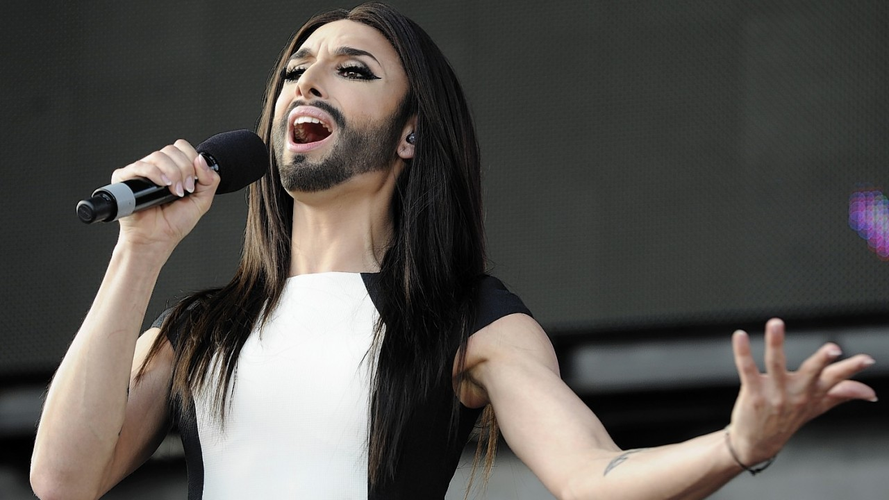 Austrian singer and Eurovision Song Contest winner Conchita Wurst performs on stage in front of the federal chancellery in Vienna, Austria