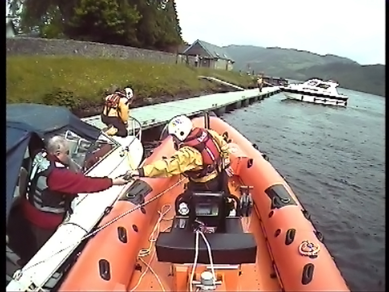 Loch Ness RNLI rescue people from cruiser stuck on rocks at Fort Augustus