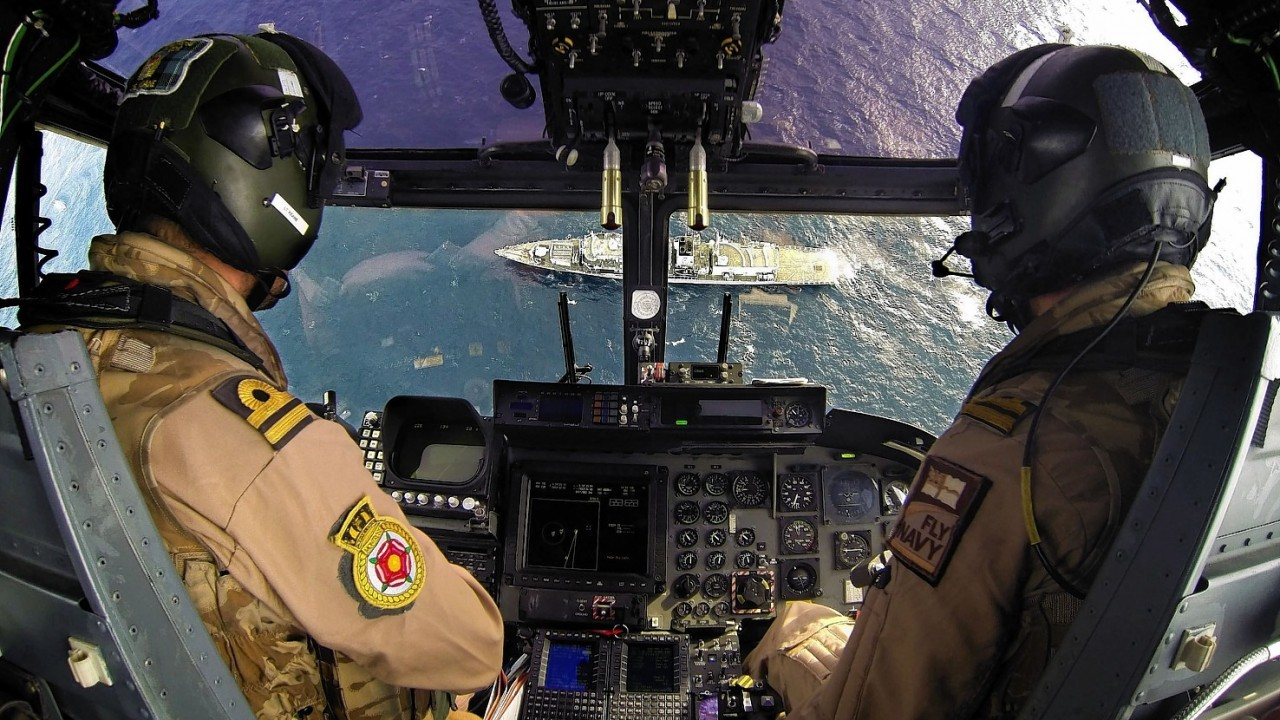 Lynx from HMS Montrose, 214 flt after carrying out a surface search of the surrounding area encompassing HNOMS Helge Ingstad, HMS Montrose and the Bulk Carrier Ark Futura during Operation RECSYR in the Mediterranean by L(Phot) Alex Knott taken from his portfolio which earned him the title of Royal Navy Photographer of the Year 2014 and Best Maritime Image Award in the annual Peregrine Trophy awards.