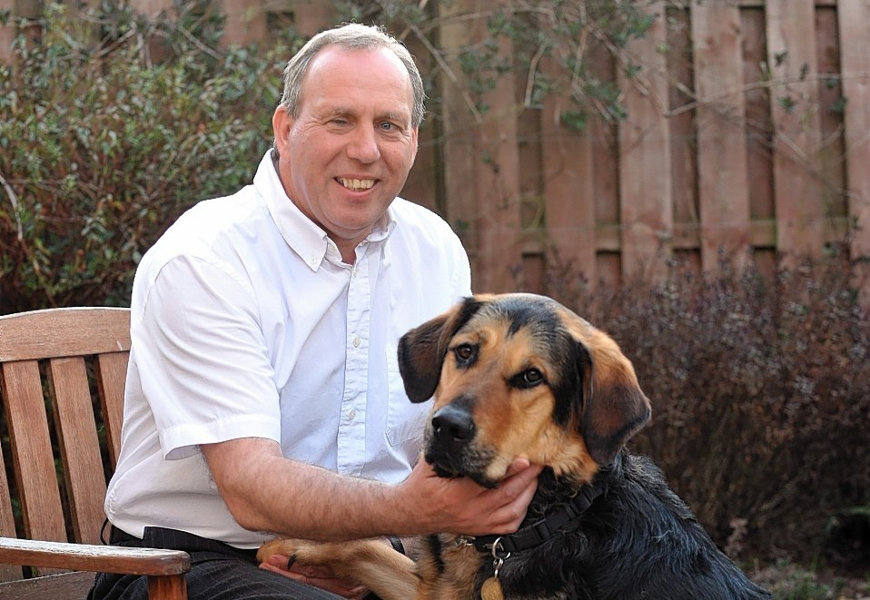 Aberdeenshire West MSP Dennis Robertson with his guide dog Mr Q.