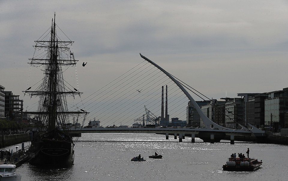 Diver Gary Hunt performs a leap from the mast of the Jeanie Johnston famine ship on the River Liffey in Dublin