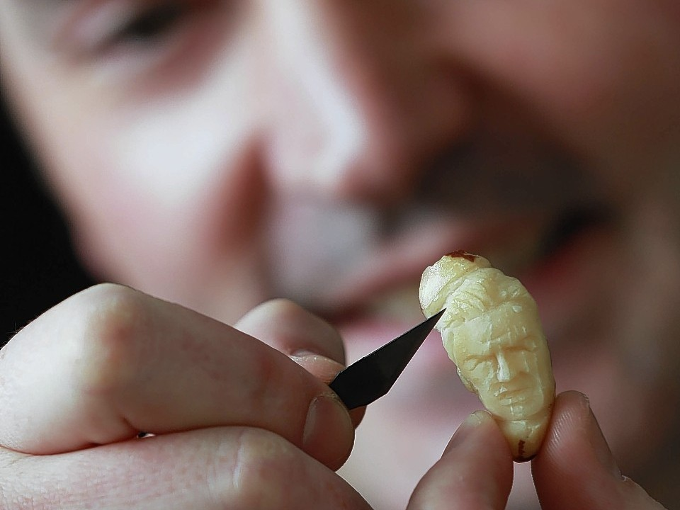 Micro-artist Quentin Devine carves portraits of England football players out of Brazil nuts to launch television channel Dave's new programme England's Top 19 Footy Heroes