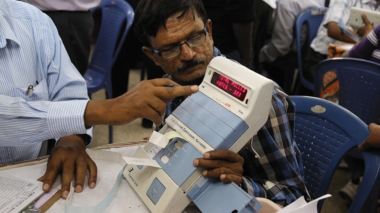 Indian election officials count votes at an indoor stadium in Kolkata, India,