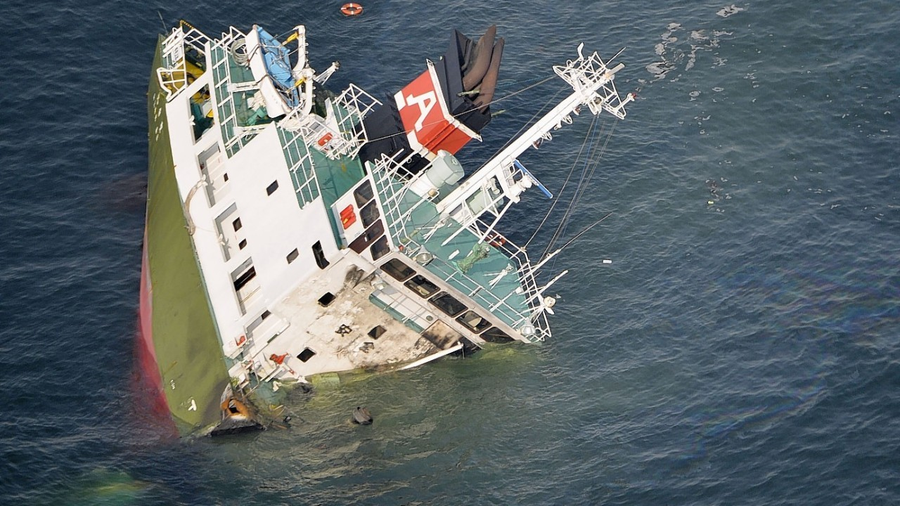 The Shoko Maru, a 998-ton tanker, sinks after it exploded in waters off Himeji port, western Japan,