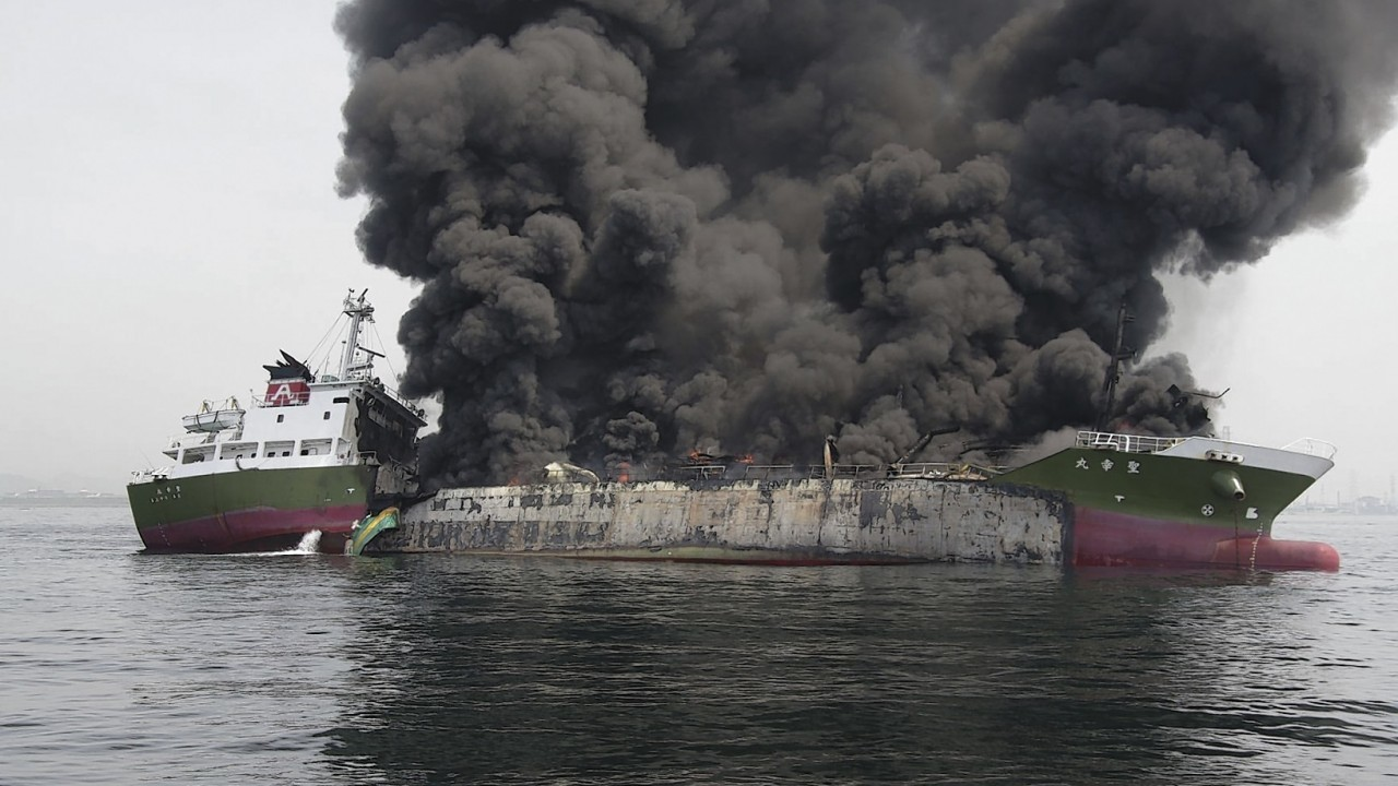 In this photo released by Japan's 5th Regional Coast Guard, clouds of black smoke billow from Shoko Maru, a 998-ton Japanese oil tanker, after it exploded off the southwest coast near Himeji port, western Japan