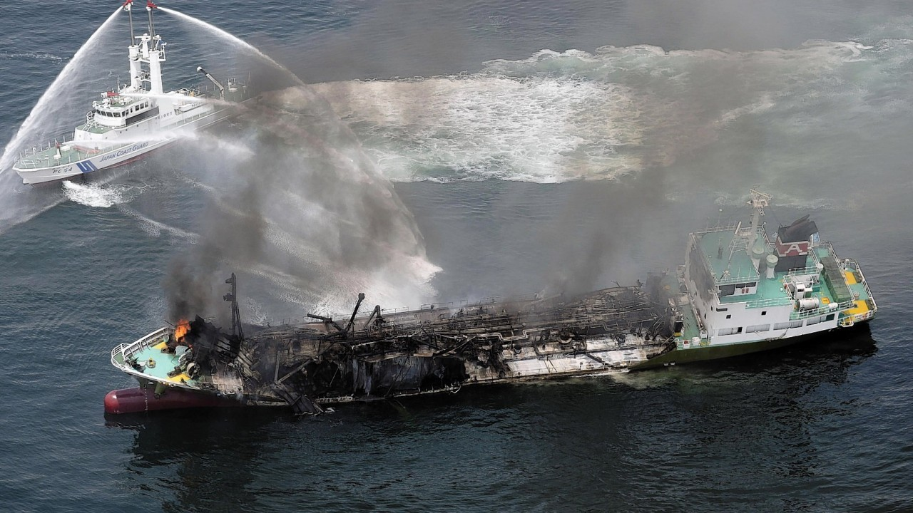 Black smoke rises from Shoko Maru, a 998-ton tanker, after it exploded in waters off Himeji port, western Japan, Thursday morning