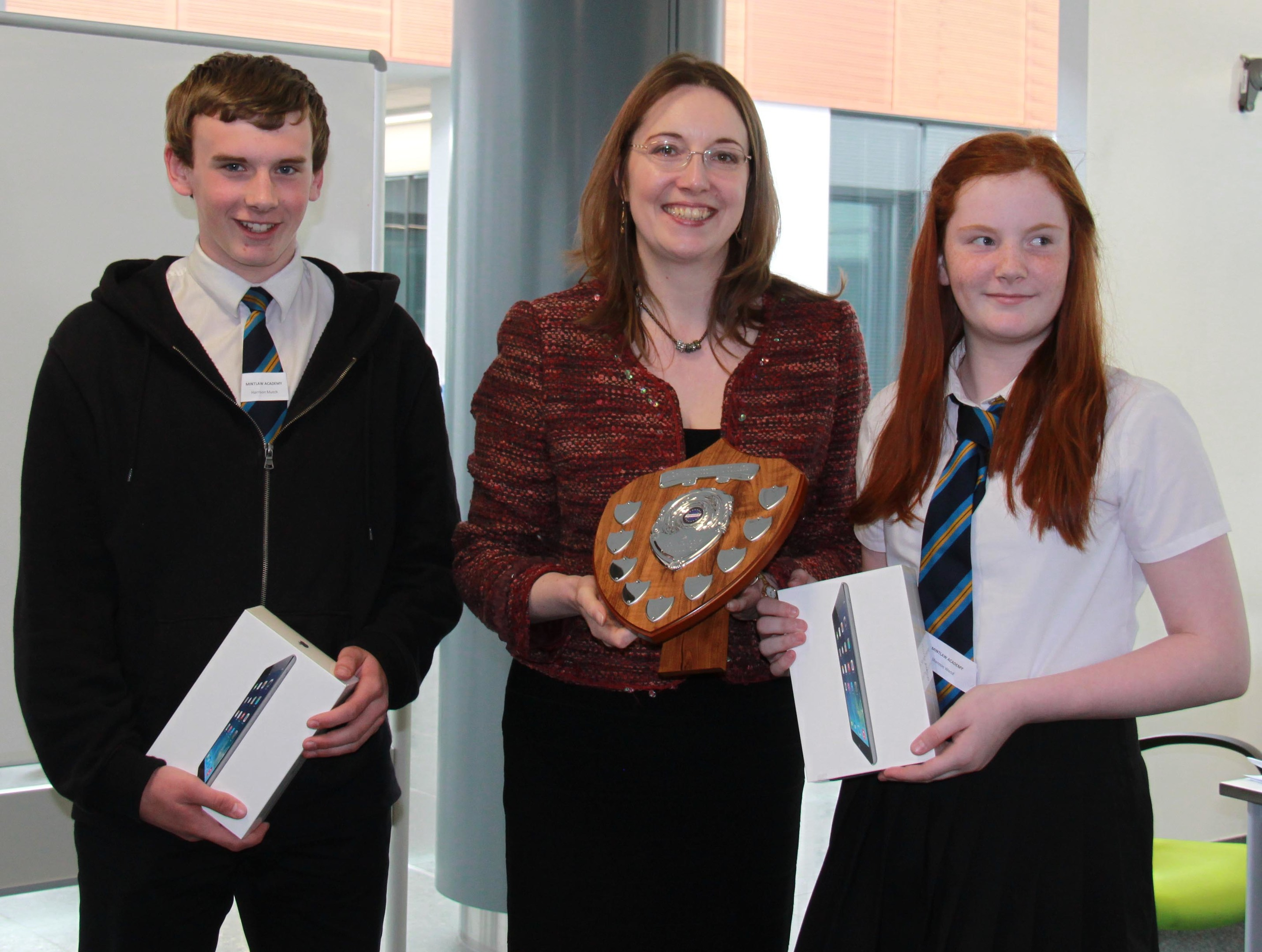 Harrison Mutch and Shannon Wood of Mintlaw Academy collect their prizes from MP Eilidh Whiteford.