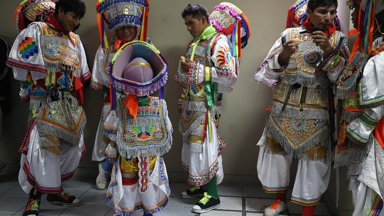 Dancers rest before a Scissor dance competition in Lima