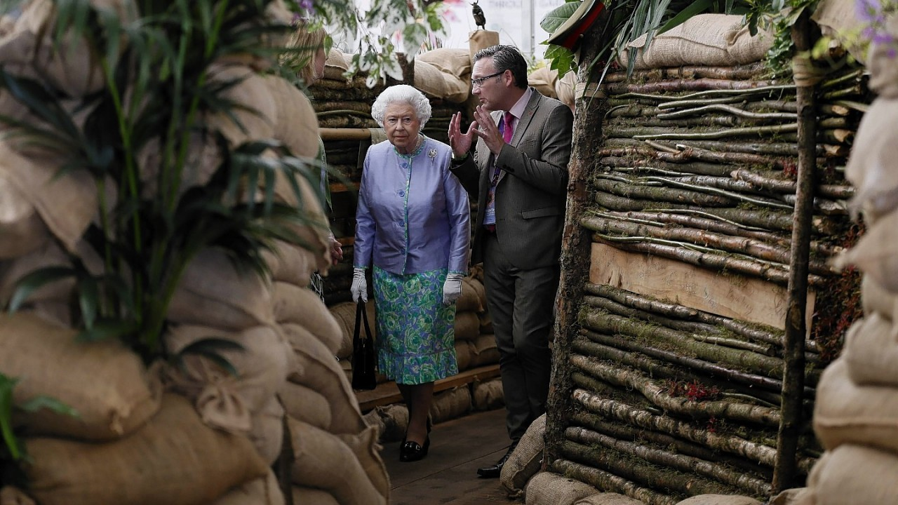 Queen Elizabeth II looks at the Birmingham City Council garden during a visit to the Chelsea Flower Show