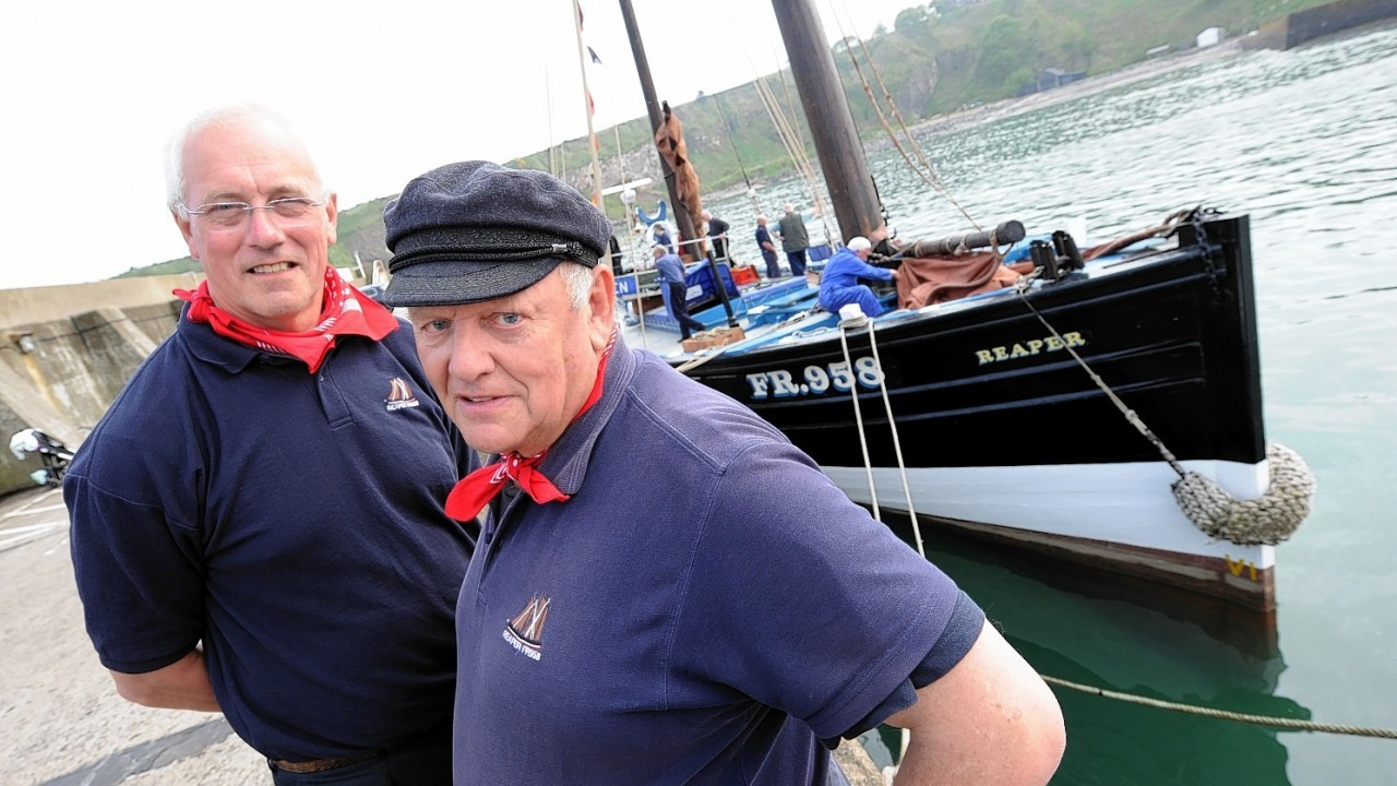 Captain Mike Barton (left) and crew member John Firn at the Reaper.