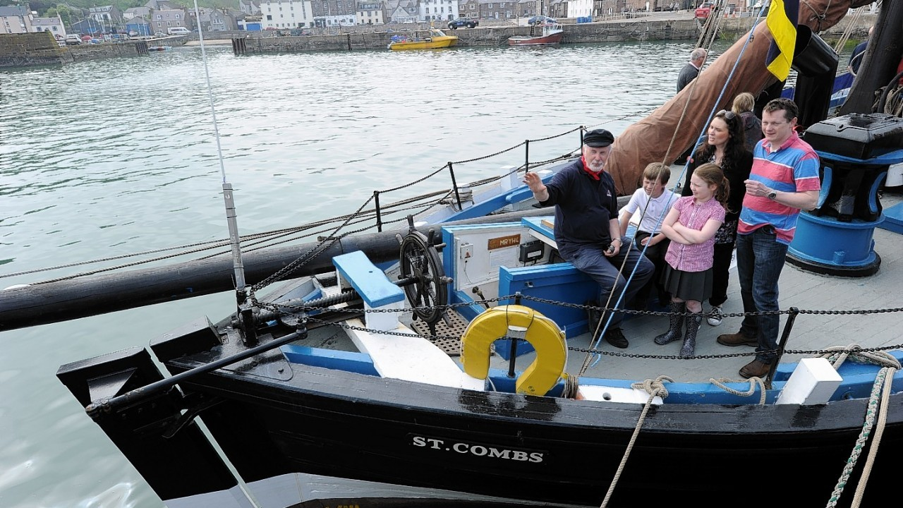 Crew member Will Taylor talks to the Macaulay family dad Graham, mum Lisa and children Blair and Rosa on board the Reaper.