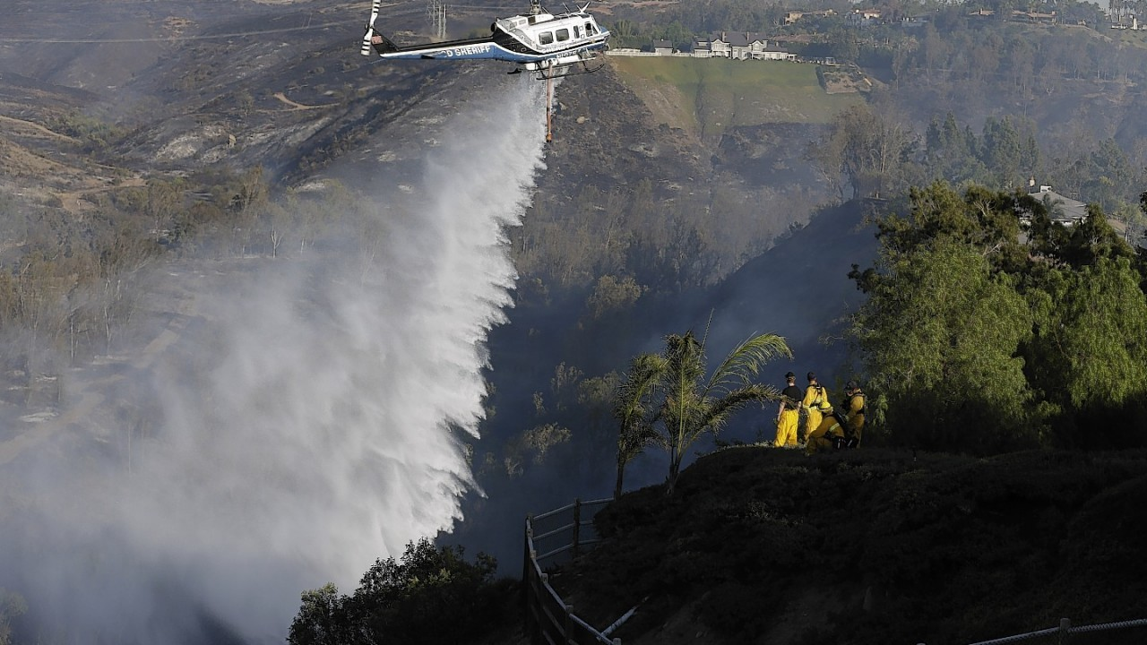Dramatic images as US emergency services battle to put out a fire near San Diego