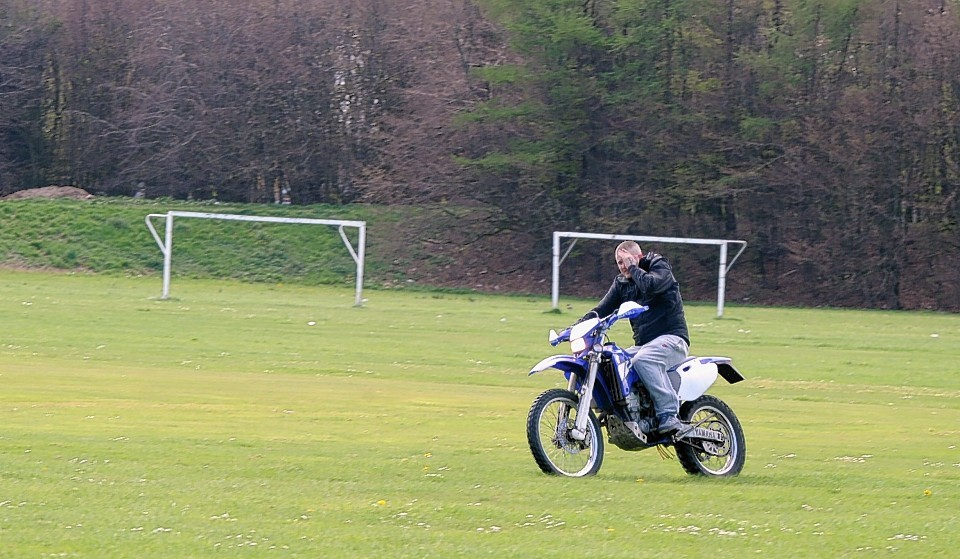 A young motorcyclist in Sheddocksley Playing Fields earlier this year