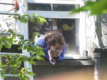 Nurse Rachel Elder gasps for breath as she tries to escape the smoke by leaning out a flat window