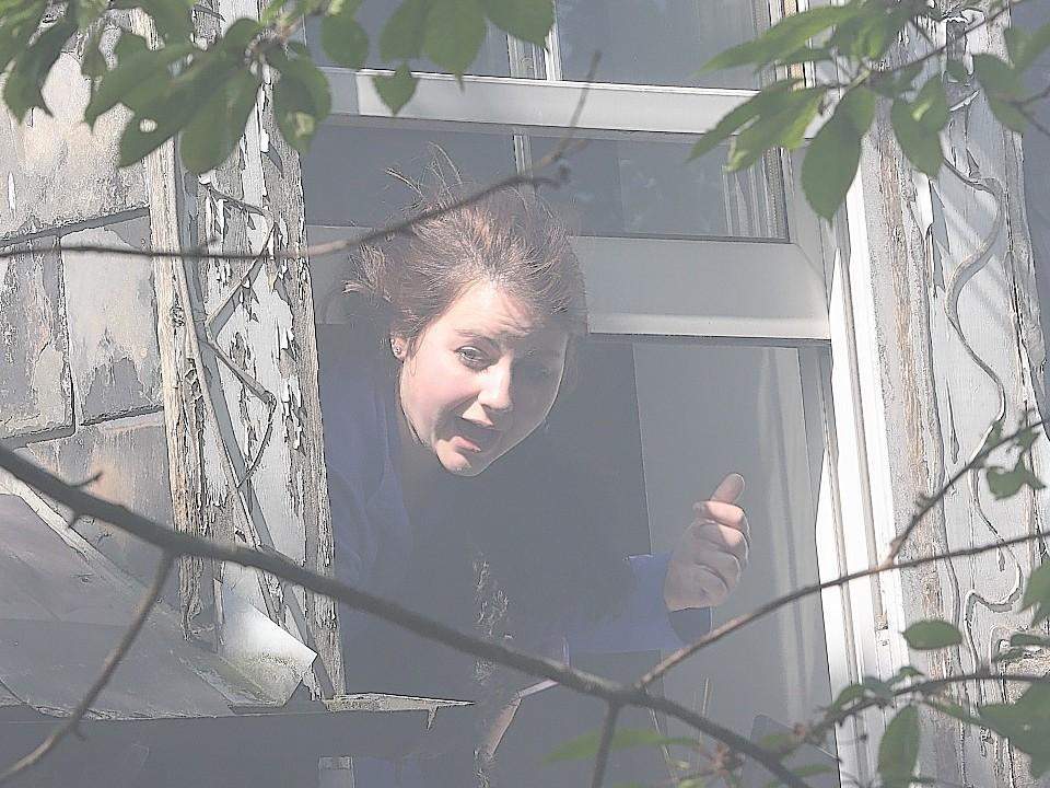 Smoke billows from the open window as Rachel screams for help