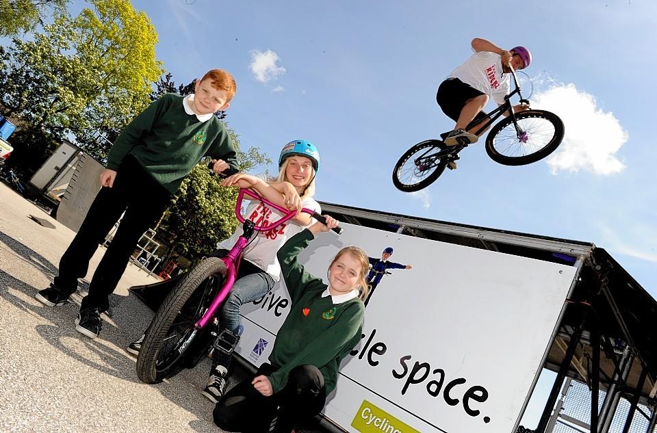 Fernielea pupils Dean Hewitt and Courtney MacLeod with BMX rider Kayley Ashworth and trials rider Luke Cockshot