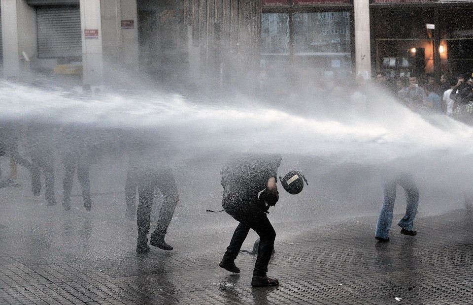 Riot police use water cannons and teargas to disperse people who were protesting the Soma mine accident that killed 301 miners, in Istanbul,