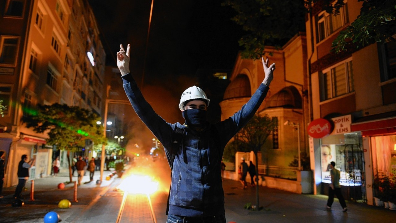Police use teargas to disperse people gathered to commemorate the Soma mine accident victims and protest the government's labor policy in Kadikoy, Istanbul