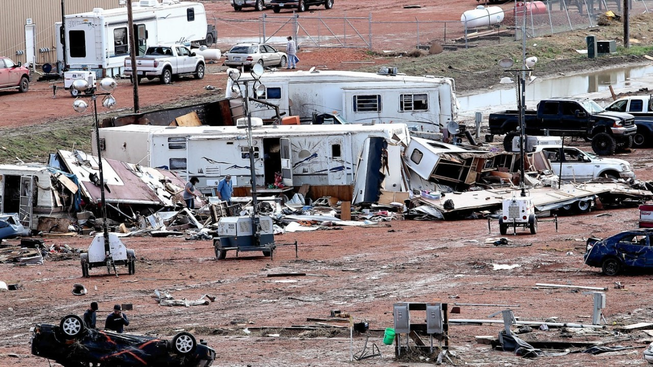 People search through wreckage Tuesday, May 27, 2014, after a tornado in Watford City, N.D. Authorities say at least eight trailers were destroyed Monday evening when the twister tore through a camp where oil field workers stay. Nine people were injured, including a 15-year-old girl critically.