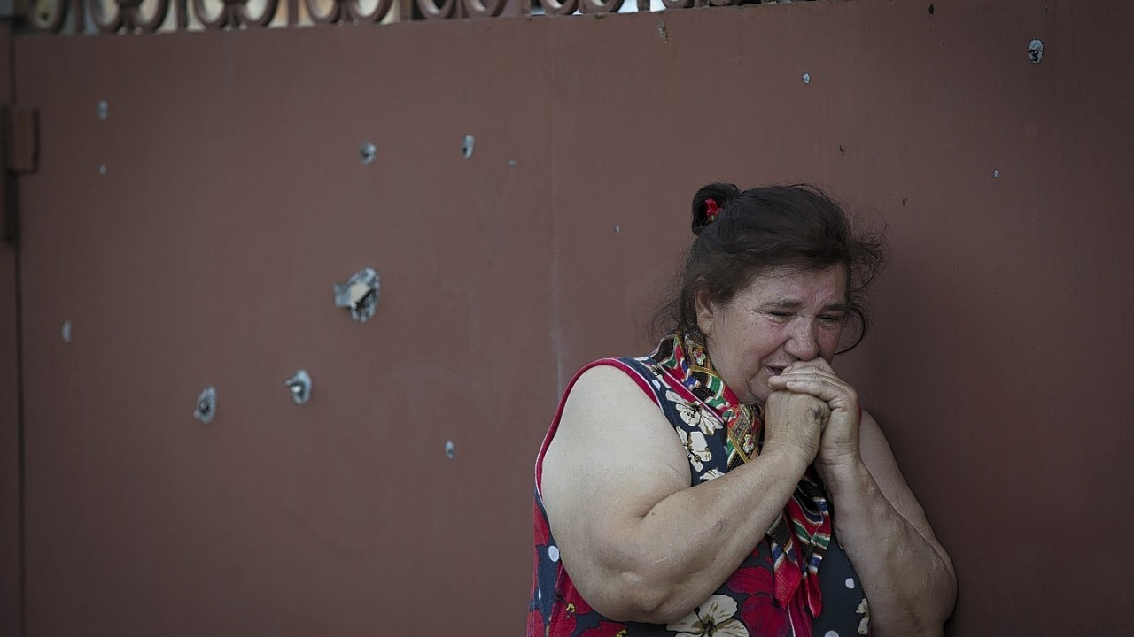 Yekaterina Len, 61, cries outside her ruined house following a shelling in Slovyansk, eastern Ukraine. Slovyansk has been the major fighting ground between pro-Russian insurgents and Ukrainian government troops in eastern Ukraine