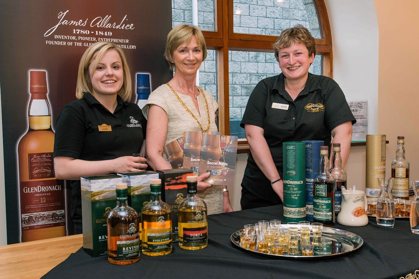 Aberdeenshire Provost Jill Webster with staff from Glendronach Distillery