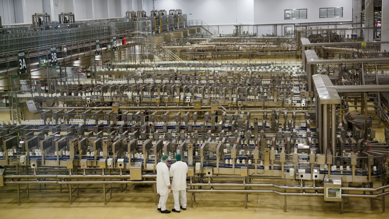 Employees at work in the filling hall on the day of the official opening of Arla Dairy, in Aylesbury.