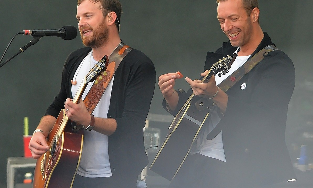The Kings of Leon with Chris Martin (right) of Coldplay performing during Radio 1's Big Weekend at Glasgow Green, Glasgow.