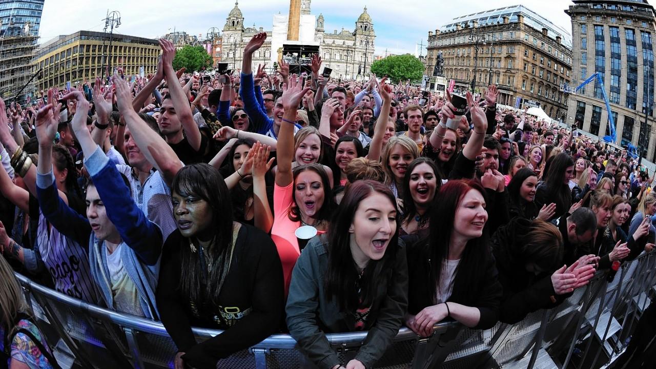 Music fans watching Annie Mac perform on stage during Radio 1's Big Weekend at Glasgow Green, Glasgow