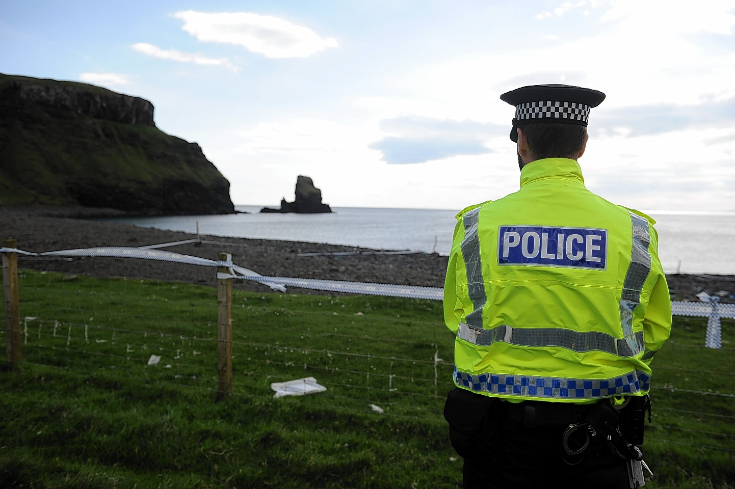 Police stand guard near the site were the grenade was found on Skye