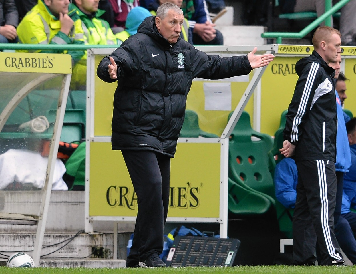 Hibernian manager Terry Butcher issues instructions from the touchline.