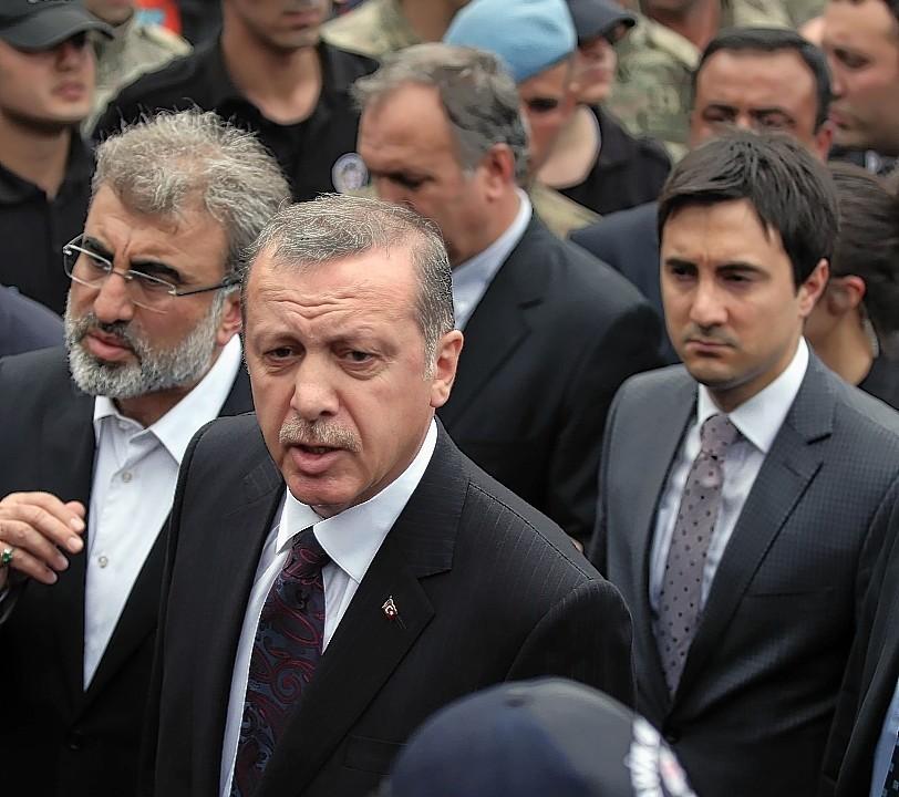 Advisor to Turkish Prime Minister Recep Tayyip Erdogan, stands behind Erdogan during his visit in Soma, Turkey
