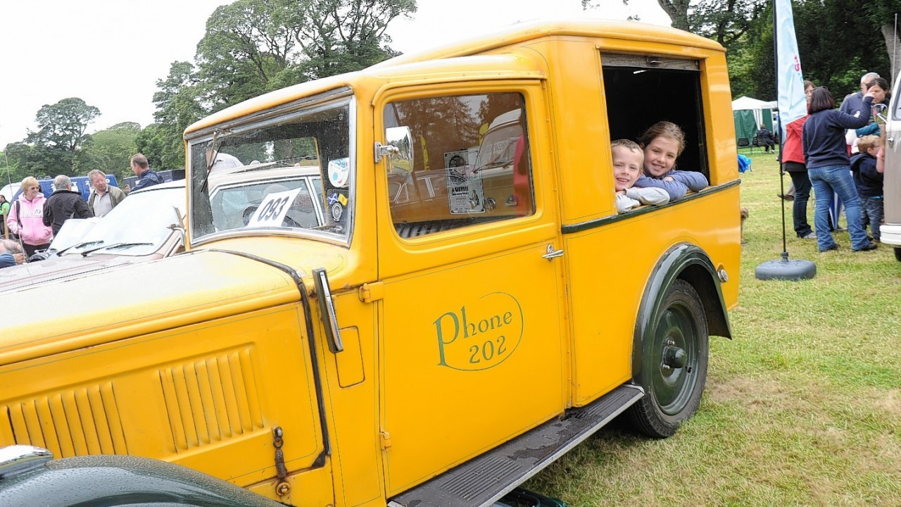 Owen Officer with his sister Amy inside a 1935 Austin 10 van