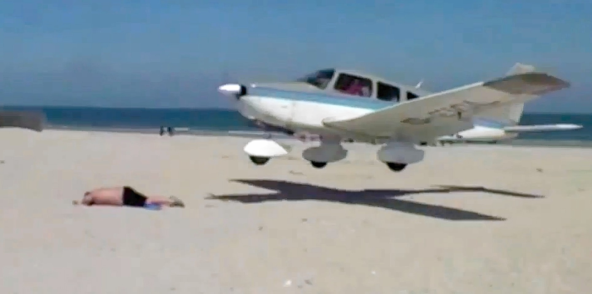 The plane came in to land, just missing a sunbather on a German beach