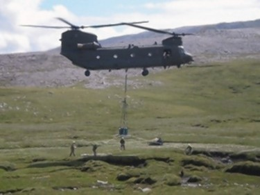 The memorial being dropped in place Ben More Assynt
