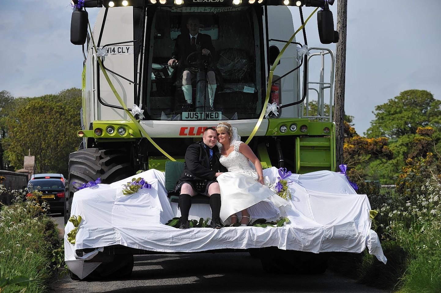 The couple's Combine Harvester wedding