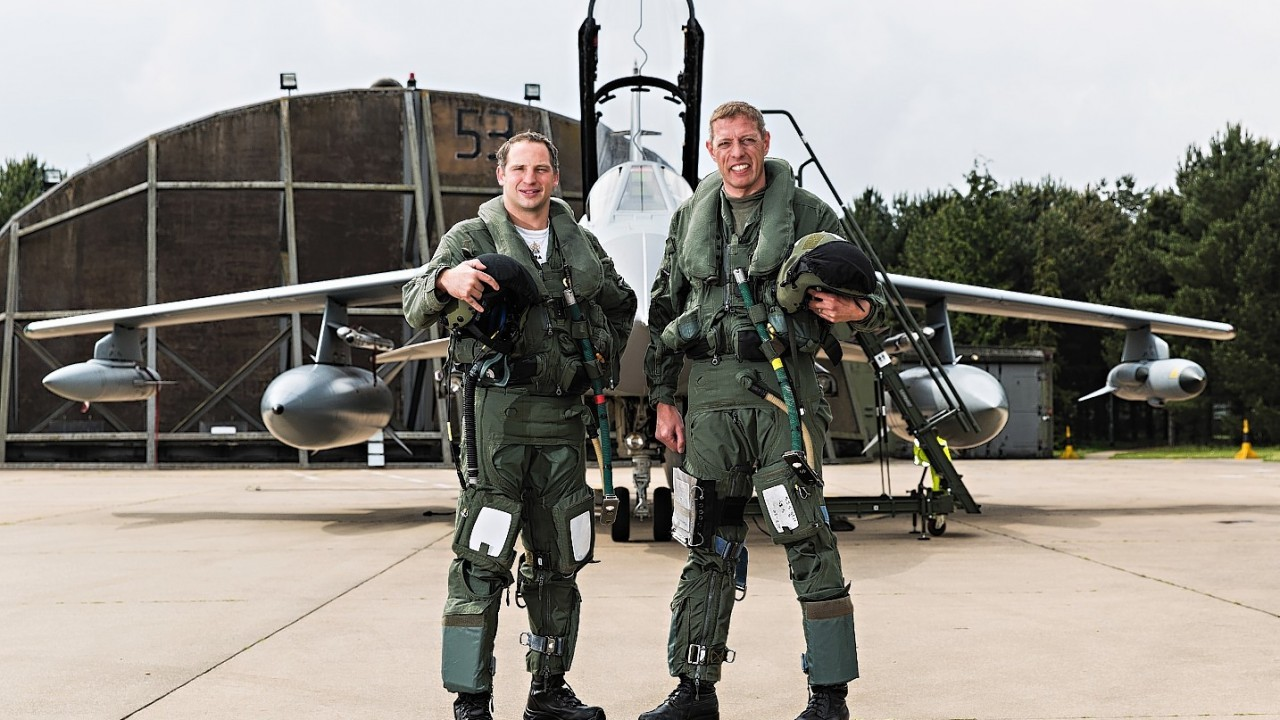 French Air Force pilot Commadant Stephane Peubez (left) and Officer Commanding II (Army-Co-Operation) Squadron, Wing Commander Jez Holmes (right) in front of the Tornado they flew over the D-Day beaches, as the two British jets recreated reconnaissance photos of the D-Day beaches in France in a bid to highlight the meticulous planning behind the landings