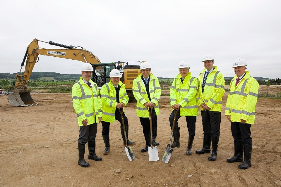 Celebrating the start of construction work, Emerson chairman and chief executive David Farr (third from the left) joined representatives from Miller Developments, local dignitaries and senior managers from Emerson Process Management at a ground-breaking ceremony.