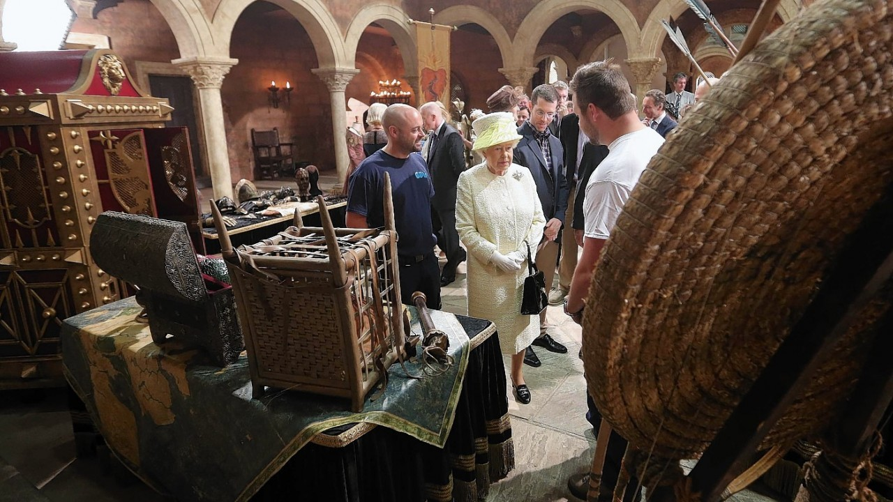 Queen Elizabeth II meets some of the costume and prop designers in the old Harland and Wolf paint room during their visit to the HBO TV series 'Game of Thrones' set in Belfast's Titanic Quarter