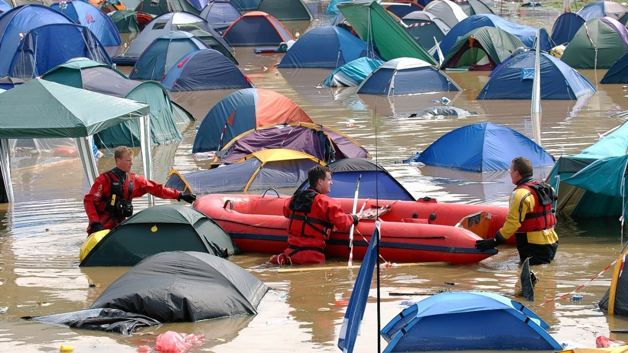 Rescue services at the scene of flooding at a campsite at the Glastonbury Festival in 2005, which starts on Friday this week