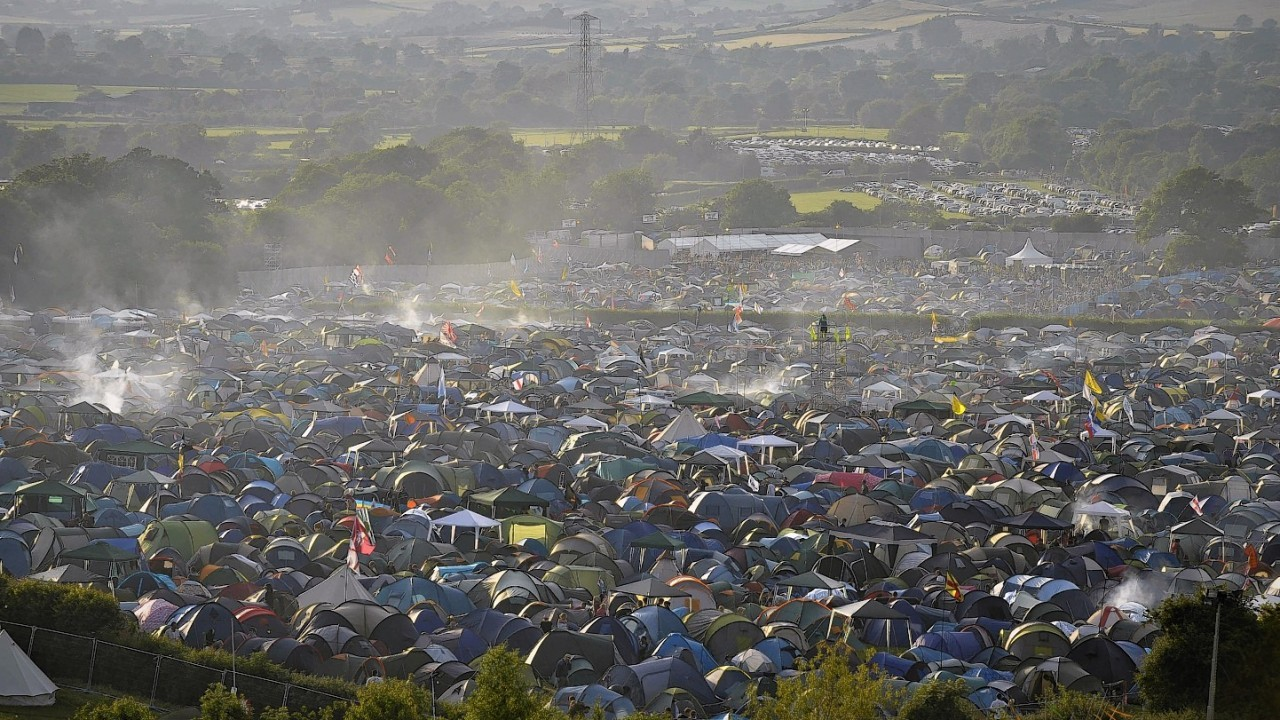 The sun setting over Glastonbury Festival in 2010, which starts on Friday this week.